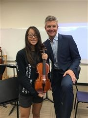 Miao '22 pictured with WCS Orchestra Director Dr. Mark Schuppener