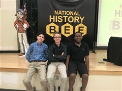 Eighth grade students Noah Lopez-Calleja, Tommy Brigham and Alex Gambrell at the History Bee Regional Finals.  Not pictured: Carolina Gentzschein