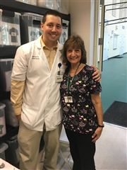 Michael Winters '04 and his mom, WCS Nurse Patty Winters, serve our community by administering flu shots.