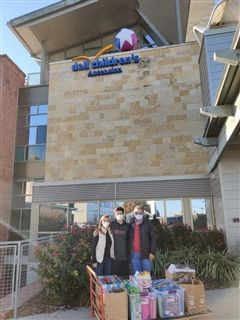 Mark Greenberg '23 delivers toys to Dell Children's Hospital