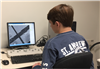 Alex on a scanning electron microscope