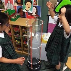 Kindergarten students experiment with a wind tunnel, May 2019