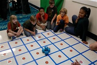 "Students challenged to code Dash the robot through a ""pumpkin patch"" to collect points for their team."