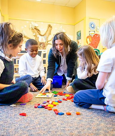 Kindergarten teacher Claire Grillo and her students take a hands-on approach to learning math.
