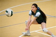 Photo by Mark Tassoni/ Reprinted with Permission.  Zhu readies to volley the ball back to the other opponent. Zhu has played on the team all four seasons that she has been in Upper School. She has enjoyed the camaraderie of the team experience.