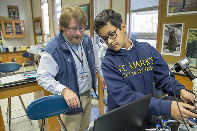"John Mead leads a student on a ""microsafari."""