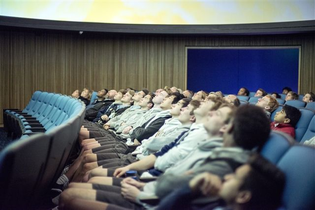 Students experience the new theater-style planetarium.