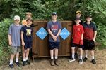 Baxter (center) with the containers he built at the Trinity River Audubon Center.