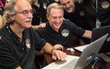 Alan Stern and his team watch data stream in from the New Horizons space craft. Photo Credit: NASA