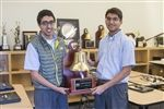 Ansh Khullar '16 and Ammar Plumber '16 hold their semifinalist trophy from the Montgomery Bell Academy debate tournament.