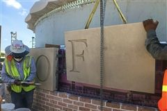 Stone lettering is installed around the rotunda.
