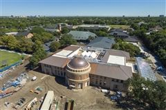 The newly-installed copper roof panels and dome have begun to patinate, naturally changing color to match the other roofs across campus.