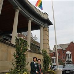 Janice and Aiden, co-heads of the Gender Sexuality Alliance, with our Pride flag.