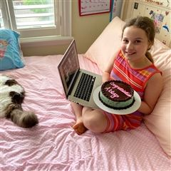 Abby and her cat Gabriel savour the big achievement.