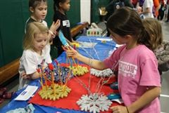 Junior School students sell homemade crafts at the Holiday Bazaar, raising over $1,800 for the Make-A-Wish Foundation.