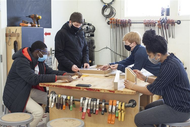 Kents Hill Community Design Build woodworking students working on solving a real-world problem