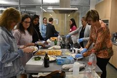 Attendees make cheese with teacher Diane Sweeney (at right)
