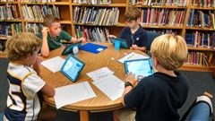 4th grade students researching space in the library using their iPads
