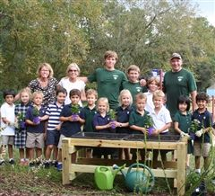 The Fouts family with Rose Ennis (far left) and her JCDS Kindergarten class