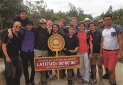 "Moeller students and teachers stand on the equator at ""La Mitad del Mundo,"" a museum outside of Quito, Ecuador where they learned about the geographical, scientific, and historical significance of being located at the center of the world."
