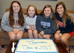 Ready to cut the cake and celebrate college choices.