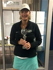 Sue Bartlett poses with her singles trophy.