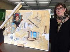 Mary Carrithers with one of her paintings.