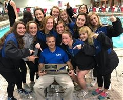 The GPS Swimming Team and Coach Dahlke with the sixth-place trophy