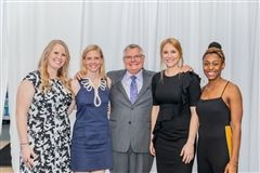From left: Heather Parman Miller '09, volleyball and track and field; Christine Anderson Cooper '09, swimming; Coach John Woods, swimming; Josie Rix '09, soccer; Jasmine Brown '09, volleyball and track and field.