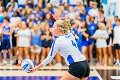 Preslee serves up the ball at a home game