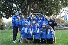 The team returns to GPS after the state meet with the trophy held high!