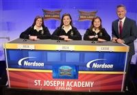 L-R: Seniors Julia Patterson, Julia Hontaruk-Levko and Cassie Van Etten with Academic Challenge host Rob Powers