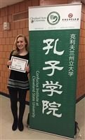 Reagan Bushok '20 with her award at the Ohio K-12 Chinese Essay Contest