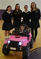 L-R: Juniors Sara Bauer, Sarah Barendt, Makena Guzzi '22 and Reagan Bushok '20 with Natalie (in vehicle) for their Go Baby Go presentation