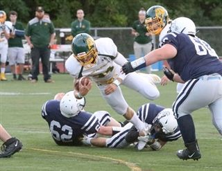 Burr and Burton quarterback Joey McCoy dives for a first down early in the Bulldogs' season opening 35-7 win over the Seawolves. It was BBA's debut in Division 1 of Vermont high school football.