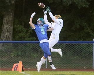 Burr and Burton wide receiver John Morgantini hauls in a touchdown pass during the Bulldogs' 47-17 win Friday night at Colchester. Morgantini caught six passes for 143 yards and three touchdowns.