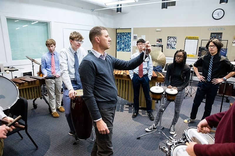 Chris Rose, a member of the renowned U.S. Marine Band, leads the growing percussion ensemble.