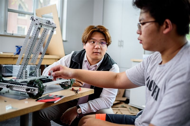 Sean Kim (pictured in the EHS robotics lab) is working with a Whirlpool engineer for his externship.
