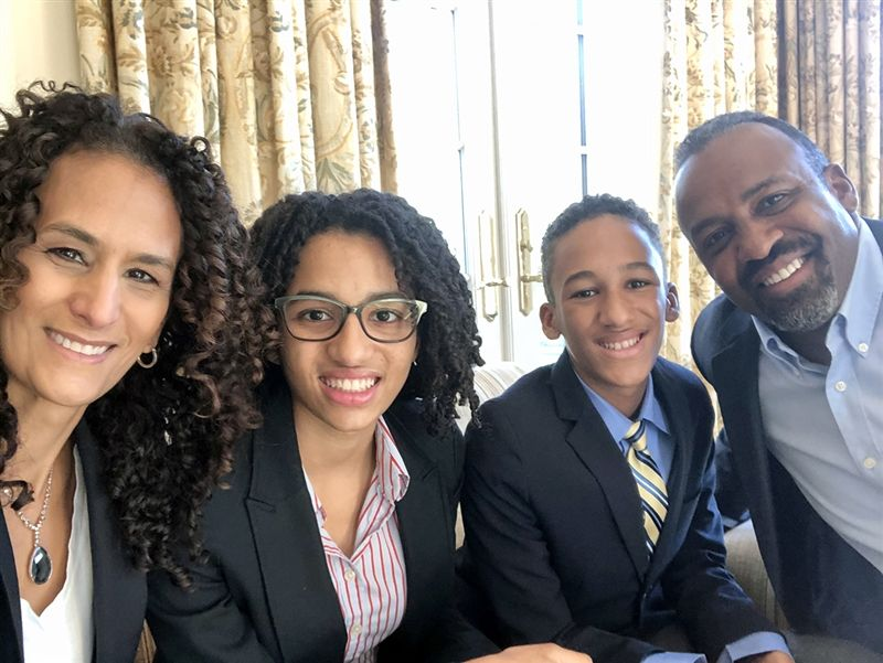 Beane (right) with his wife, Jodie, and children, Anani '24 and Jonathan '24.