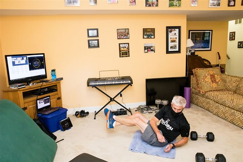Wrestling coach Steve Castle ran virtual workouts for his team from his basement.
