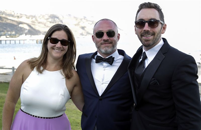 James Rizzo '96 (center) and his wife, Becca, with Marc Carlini '97.