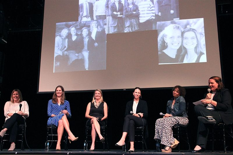 First 48 panelists Amy Fannon Cupic '94, Gretchen Byrd '95, Sarah Baltimore McElwain '95, Comer Shuford Wear '95, and Patrice Scott Williams '95 sit with Lucy Whittle Goldstein '97 on the Pendleton stage.