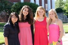 A photo of Tyler Duerson '12 (second from left) during her time as a student at EHS.