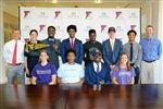 Head of School Charley Stillwell (far left) and Athletic Directors Jen Fitzpatrick and Jim Fitzpatrick (right) with nine EHS student-athletes who announced their college commitments yesterday.