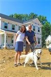 Teachers Rocío Mendizabal and Tim Rogers earlier this summer in front of their new home, one of four recently completed for faculty.