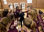 Longtime coach Kim Adams with her volleyball team last year.