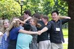 New and returning students work to untangle themselves from a human knot on Move-In Day.