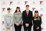 The fall commitment ceremony recognized four students who have committed to play Division 1 athletics in college next year. They are (from left) Miles Thompson, Lexi Weger, Zach Pfaffenberger, and Eleanor Winants.