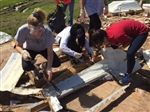 EHS students clear a devastated home site so that rebuilding can begin.