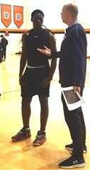 Nana Owusu-Anane '21 (Burlington, Ontario) speaking with Yale Assistant Coach Justin Simon